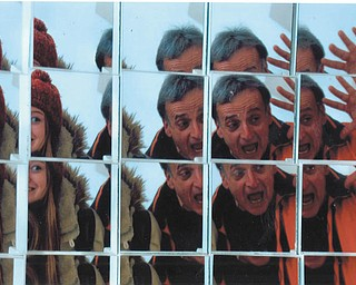 In March Leanna Hartsough and Richard Bucurel enjoyed making funny faces in a mirror at the Butler Art Museum. Photo by Lana VanAuker.