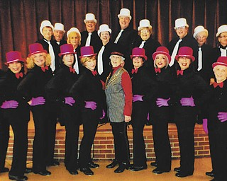 """SPECIAL TO THE VINDICATOR The Trumbull Senior Production Company, under the direction of Jason Burgermyer, recently entertained the Daughters of the American Revolution at their George Washington Tea. In front, from left, are Jean Bolinger, Judy Mackey, Leslie Wilkinson, Elaine Morgan, Kay Beler, Dorothy Lazar, Susette Liddle, Lupe Cohen, Becky Noftsinger and Rubylee Jordan. In back are Debbie Rader, Bill Luzar, Dorothy Luzar, Fred Fulton, Carol Bovee, Burgermyer, Mary Ann Fields, Joanne Bode, Jo Ulery and Alice Cosgrove. The production company is rehearsing for its upcoming show, """"Razzle Dazzle,"""" which will be performed at 7 p.m. May 10 and 2 p.m. May 11 at Champion High School, 5976 Mahoning Ave. NW (state Route 45)."""