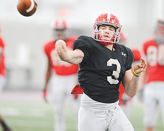 Junior quarterback Dante Nania throws a pass after scrambling out of the pocket during a spring practice at the WATTS. He's one of four quarterbacks vying for the starting job.
