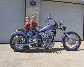 In 2005 4-year-old twins Jakob and Jarid Armeni give two thumbs-up to their dad, Ralph Armeni, builder of this 2002 custom Harley.