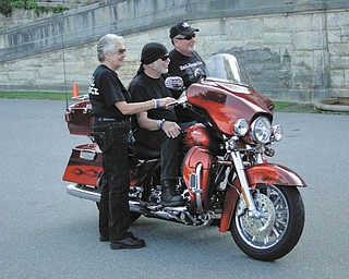 Nancy Davidson, left, and Willie G. Davidson, grandson of one of the founders of Harley-Davidson, and Joe Dowd, manager of Harley Owners Group, all from Milwaukee, Wis. Taken by Chuck Cavanaugh.