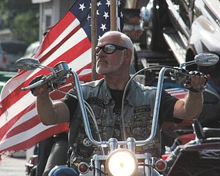 Dr. Frank Daniels taken in Boise, Idaho, as he rides proudly before the American Flag. Taken by Chuck Cavanaugh.