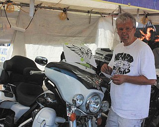"""Steve Chaszeyka, """"The Wizard,"""" of New Middletown, is working on the details of his bike. Taken by Chuck Cavanaugh."""