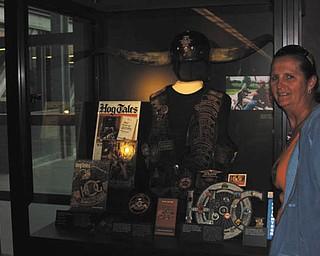 Jayne Rohleder Zaleski of Milwaukee, Wis., with a display of memorabilia of her deceased boyfriend, Arlen Strehlow, the man with the horns. Taken by Chuck Cavanaugh.