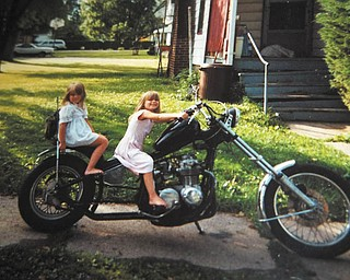 These are twin sisters, Megan and Michelle Nitzsky, when they were 5 years old on their dad's motorcycle. Sent by George Nitzsky