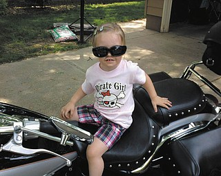 Addison Pollock is enjoying the thrill of sitting on a big motorcycle, sent by grandparents Rob and Donna.