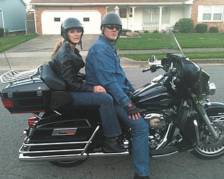 Bob and Donna Casey sitting on Bob's '06 Electra Glide.