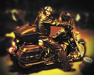 """Bob Holton of Boardman """"glows"""" on a 2005 Harley Davidson Heritage Softail Classic. Submitted by his wife, Diane Theis."""