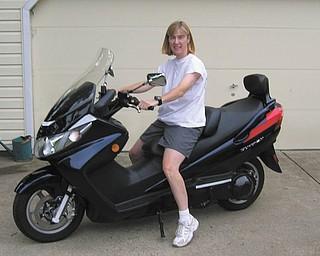 Bettyann Nagy with her Suzuki Bergman 400 Scooter.