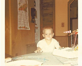 David Bortmas, 1, did it and was caught in the act in 1970 by Mom, Donna Hunt. David now lives in Lake Milton.