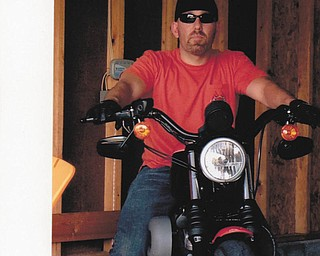 Mike Moss of Austintown is getting ready to ride his Harley Nightster. Submitted by his mother, Diane Moss.