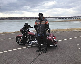 Mike Moss of Austintown is riding his Harley Street Glide to Lake Milton on a very cold spring day this year. Sent by his mother, Diane Moss.