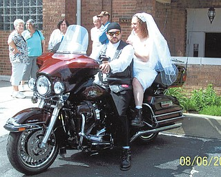 Newlyweds Michael and Apryl Parrilla, were married June 8, 2013, at Holy Apostles Parish in Youngstown by the Rev. Joseph Rudjak, who also rides a Harley. Submitted by Mike and Kathy Parrilla, Michael's parents.