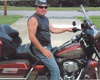 Bobby Davis of Austintown is seated on his Harley and smiling from ear to ear. This was taken by Leslie Schuler of Youngstown.