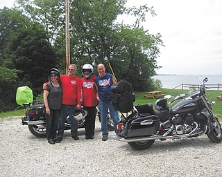 Therese Olesky, Bill Olesky and Catherine and Jim Santangelo with a picnic area and beautiful Lake Erie at Erie, Pa., in the background.