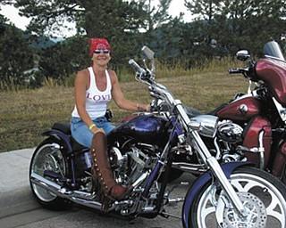 Priscilla Umbrazun sitting on her bike in Sturgis, South Dakota, on her way to Mount Rushmore.