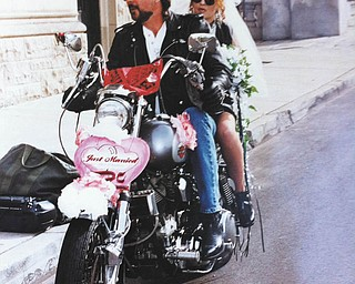 This was taken outside the Chapel of Friendly Bells at Trinity Methodist Church, downtown Youngstown, immediately after David and Kathleen Jones of North Lima were married, Oct. 16. Their wedding attire coordinates with the Harley. After the ceremony they jumped on the bike and rode in the YSU Homecoming Parade.