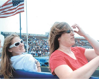 Heidi VanAuker of Canfield with her daughter, Leanna, on a windy day at a track meet. Sent by Lana VanAuker of Canfield.