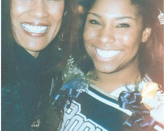 Michaela Warren and daughter Jasmine, both of Lowellville, shared the joy of her senior night at Lowellville High School in October 2012.