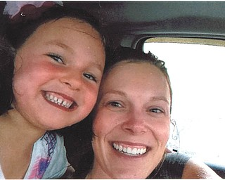 Addison Williams, 7, and her mom, Ericka, both of Austintown, after running through the rain to their car after shopping, a bit wet but still smiling!