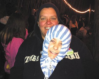 Mom's are always protecting their babies. This includes keeping them warm. Barbara Lorenzini's daughter, Debbie Schmidt, was doing just that with her daughter, Madyson, while they waited in line for a ride at Disney World on a chilly night.