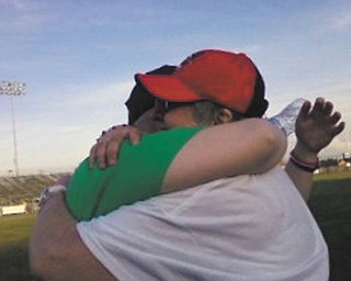 Taken May 17, 2013, at the Boardman Relay For Life, just four months after Melissa Magan's father died after battling cancer twice. She and her mom, Sandra Magan, embraced as the tears flowed.