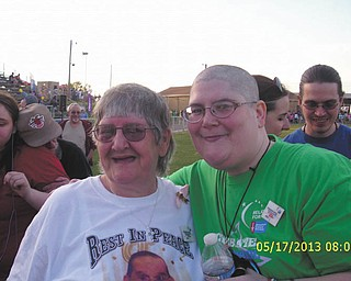 """Before Melissa Magan's father died, she jokingly told him she was going to shave all her hair at the Relay for Life, and he said, """"I dare you!"""" So Melissa formed a team and completed her father's dare. Her mom, Sandra Magan, wore a shirt with his face on it to honor his memory."""