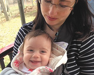 It's Alena and Abigail Vollmer's first trip to the Cleveland Zoo ... on the outback train. They live in Warren.