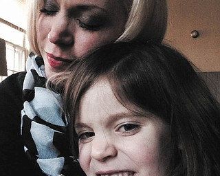 This is Terri Liller and her daughter Harper, 6, snuggling, while Harper shows off her missing tooth.