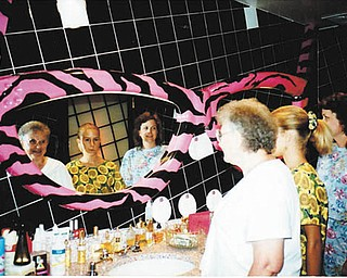 """Mary Louise Gary, mother of Dianne Phillips of Poland, and Dianne's daughter, Elizabeth Soich of Boardman, and Dianne are looking in the rest room mirror at Planet Hollywood in Miami, Fla., celebrating Dianne's 40th birthday. Dianne says """"Like mother like daughter is the nicest compliment there is."""""""