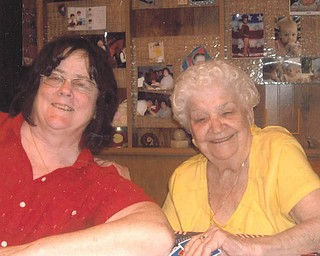 A moment to smile together is shared by Florence Dailey of Youngstown, left, and her mother Mary Rita Bodnar of Austintown.
