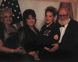 Grandma Rose Makosky of Campbell, mom Vikki Pavis of Youngstown, daughter and Marine, Heather Leith of Fredericksburg, Va., and grandfather, John Makosky, also of Campbell, at a Marine Corps Ball in California in 2006.