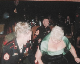 """Heather Leith and her grandmother, Rose Makosky, are """"getting groovy"""" at a Marine Corps Ball in California in 2006."""