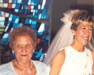 Helen DeSimone and her daughter Roseann Cullen shared one of their happiest moments Aug. 18, 2000, when Helen walked her daughter down the aisle. RoseanneÕs father died when she was 16.
