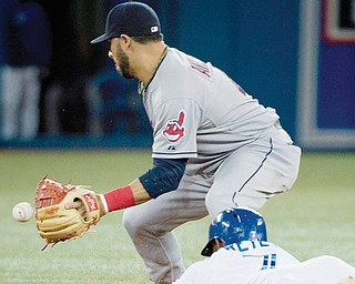 The Blue Jays Jose Reyes slides safely into second base ahead of the throw to the Indians's Mike Aviles after doubling to left field in the sixth inning of their baseball game Thursday in Toronto. The Blue Jays edged the Indians, 4-2.