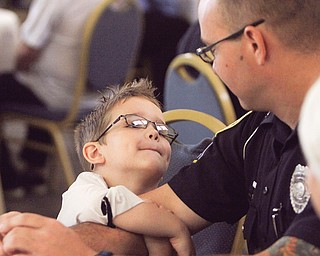 Officer George Anderson gets a hug from his son Declan, 5, just before Anderson received one of his awards.