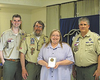 SPECIAL TO THE VINDICATOR  The Harnishfeger family of Boardman was named the 2013 Scouting Family of the Year at a Scouting awards event in April. From left are Preston Cockrell, presenter, Byron and Beth Harnishfeger and District Chairman Kurt Hilderbrand. Karl Harnishfeger also is part of the family.
