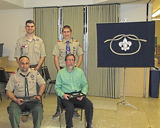 The 2013 Whispering Pines District Award of Merit recipients are, in front from left, Tony Ricciutti and Randy Osiniak, both of Boardman. In the second row are Preston Cockrell and Matthew Osiniak, Randy's son.