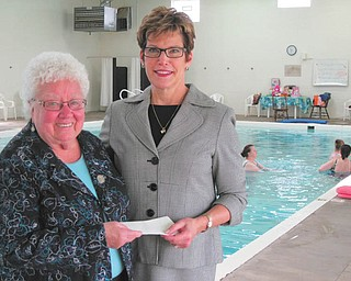 SPECIAL TO THE VINDICATOR  Ursuline Center receives $20,000 grant for project The Youngstown Foundation recently awarded the Ursuline Center in Canfield a $20,000 grant for its Motherhouse pool ministry new roof project. Jan Strasfeld, right, executive director of the Youngstown Foundation, presented the check to Sister Nancy Dawson, OSU, general superior of the Ursuline Sisters of Youngstown. The center is the education facility operated by the Ursuline Sisters of Youngstown. The roof project is part of a two-phase renovation that will cost a total of more than $66,000. Donations are welcome for this project and for a new heating project to replace the entire HVAC system for approximately $115,000.