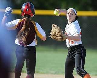 NORTH LIMA, OHIO - MAY 19, 2014: Infielder Hallie Stamm #25 of Newton Falls looks to first base before the throw after steping on second base to force out base runner Caragyn Yanek #7 of South Range during a game at South Range High School. (Photo by David Dermer/ Youngstown Vindicator)