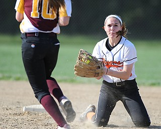 NORTH LIMA, OHIO - MAY 19, 2014: Infielder Hallie Stamm #25 of Newton Falls prepares to tag out base runner Lydia Baird #10 of South Range during a game at South Range High School. (Photo by David Dermer/ Youngstown Vindicator)
