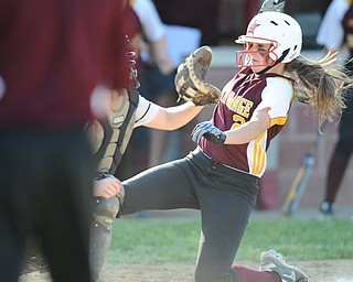 NORTH LIMA, OHIO - MAY 19, 2014: Base runner Jessica Skirpak #2 of South Range slides into home plate to score the game winning run in the bottom of the 9th inning during a game at South Range High School. (Photo by David Dermer/ Youngstown Vindicator)