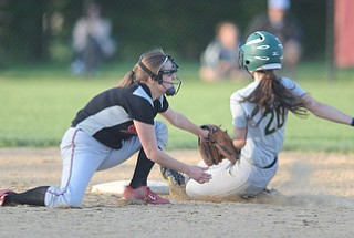 NORTH LIMA, OHIO - MAY 19, 2014: Base runner Anny Carroll #20 of Ursuline is tagged out trying to steal second base by infielder Mel Bakes #4 of Girard during a game at South Range High School. (Photo by David Dermer/ Youngstown Vindicator)