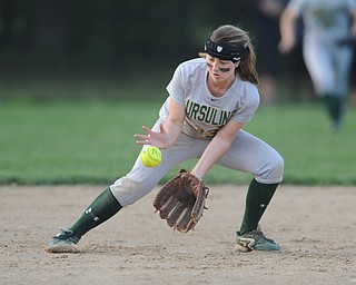 NORTH LIMA, OHIO - MAY 19, 2014: Infielder McKenzie Stimpert #33 of Ursuline fields the ball before throwing it to first for the third out in the top of the 7th inning during a game at South Range High School. (Photo by David Dermer/ Youngstown Vindicator)