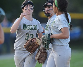 NORTH LIMA, OHIO - MAY 19, 2014: InfieldersMcKenzie Stimpert #33, Macey Gunther #7 and pitcher MaKayla Shore #00 of Ursuline celebrate after the final out of the game during a game at South Range High School. (Photo by David Dermer/ Youngstown Vindicator)