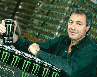 In this Nov. 10, 2005, photo, Rodney Sacks, CEO of Monster Beverage, poses for a photo in Corona, Calif. Sacks earned $6.22 million in 2013, a near sevenfold increase.