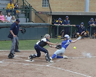 Katie Rickman | The Vindicator.Poland's Taylor Miokovic (no. 15) slides in safe and scores the only point for Poland during the tournament against Tallmadge in Akron May 28, 2014. Catcher Tori Young (no. 21) stands on home plate in attempt to tag her out.