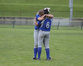 Katie Rickman | The Vindicator.Poland's Phoebe Bush (no. 6) embraces team mate Chloe Bush after the team lost to Tallmadge 1-5 in Akron May 28, 2014.