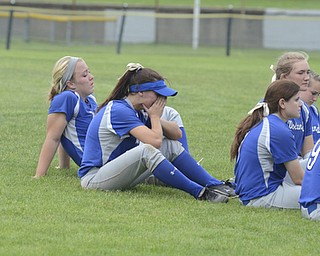 Katie Rickman | The Vindicator.Phoebe Bush cries as the team gathers on the field after losing to Tallmadge 1-5...Taylor Miokovic leans back and listens as the coach talks to the team.