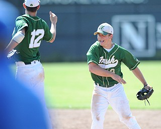 MASSILLON, OHIO - MAY 29, 2014: Infielders Gianni Quattro #12 and Joel Hake #8 of Ursuline celebrate after the game ending double play turned by Hake during a OHSAA tournament game at Massillon Washington High School. Ursuline won 7-5. (Photo by David Dermer/Youngstown Vindicator)